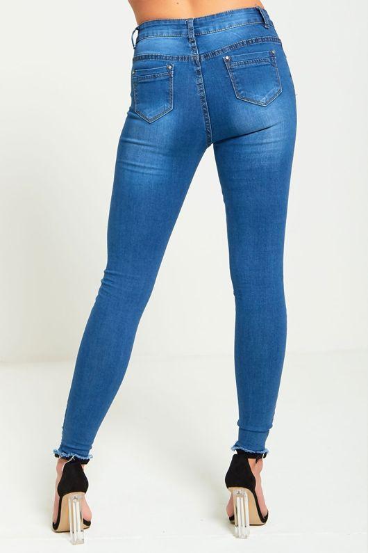 Frayed Hem Mid Rise Classic Wash Denim Jeans